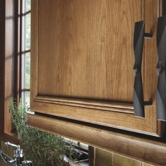 Kitchen Cabinet Hardware Countertops Types Decorative Omega Cabinetry Detail Of Pulls On Delray Cherry Doors