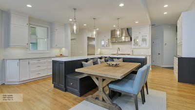Kitchen Featuring an Island with Bench Seating - Omega
