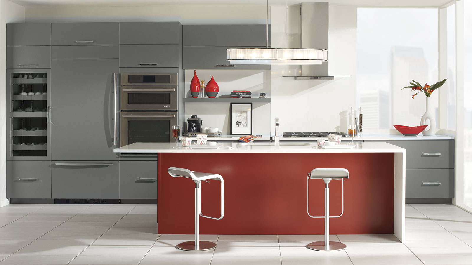 small open plan kitchen living room layout blue accent chairs gray cabinets with a red island - omega cabinetry