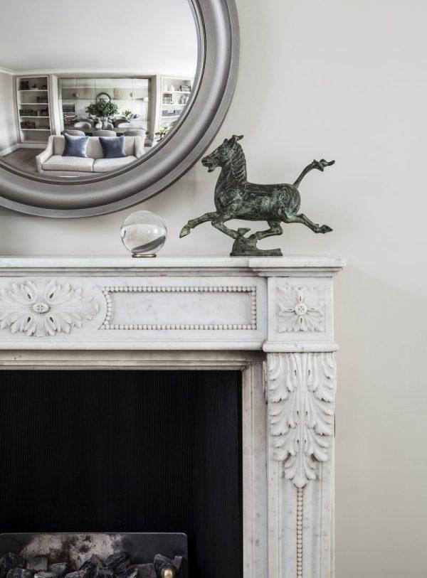 Round Mirror above Fireplace