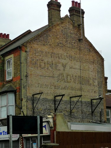 """Ghost sign located in Hounslow, London. Photo from Flickr user """"Ewan Munro"""" - Creative Commons"""