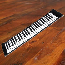 Flat piano on a wooden floor
