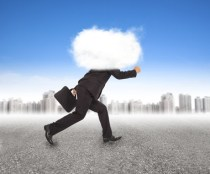 businessman running with head in the clouds in outdoors