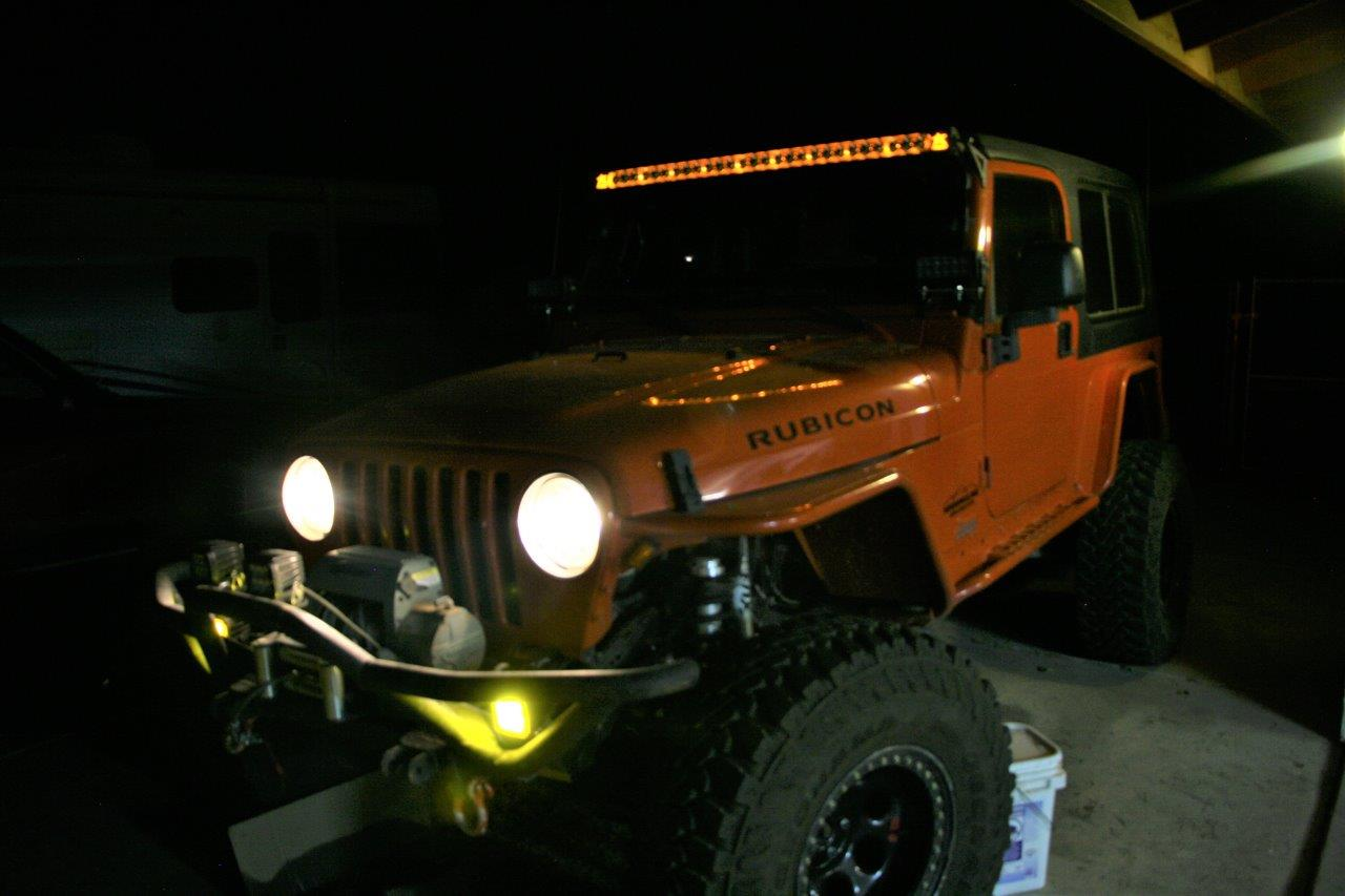 hight resolution of we chose amber background lighting for the overhead light bar because we feel it complements the orange paint on the jeep and almost appears orange when on