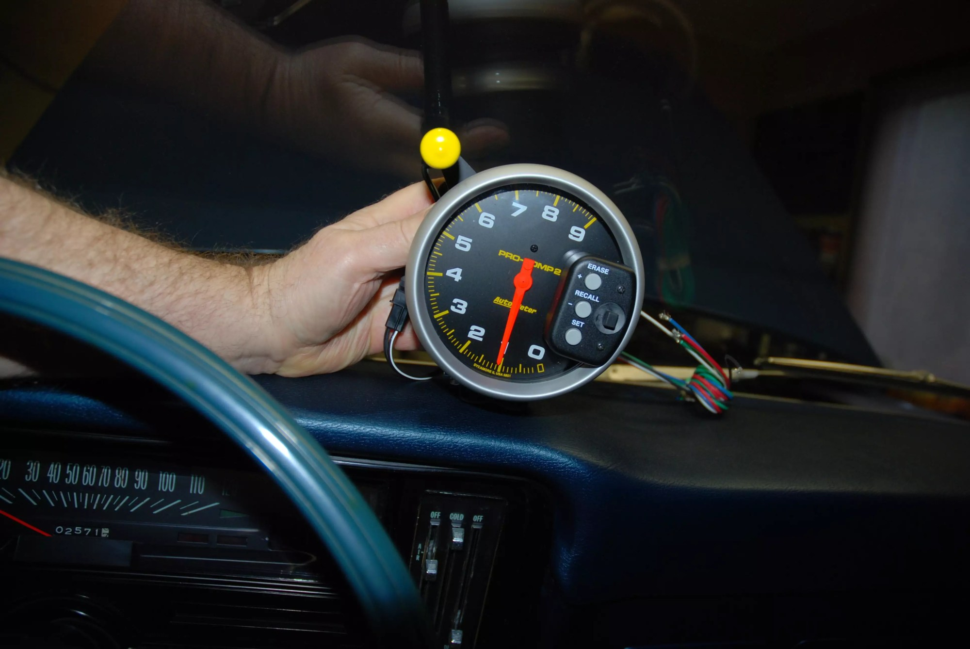 hight resolution of when mounting the tach it s a good idea to try it in various mounting locations in the car here we ve tried the tach right on the dash and also on the
