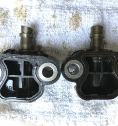 one the tensioner on the left was the one that broke through the guide and is missing a considerable amount of the head from the timing chain  [ 4032 x 3024 Pixel ]