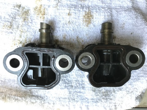 small resolution of one the tensioner on the left was the one that broke through the guide and is missing a considerable amount of the head from the timing chain