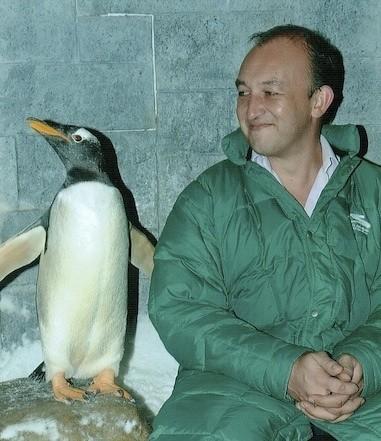 Adriaan Bloem and a Gentoo penguin