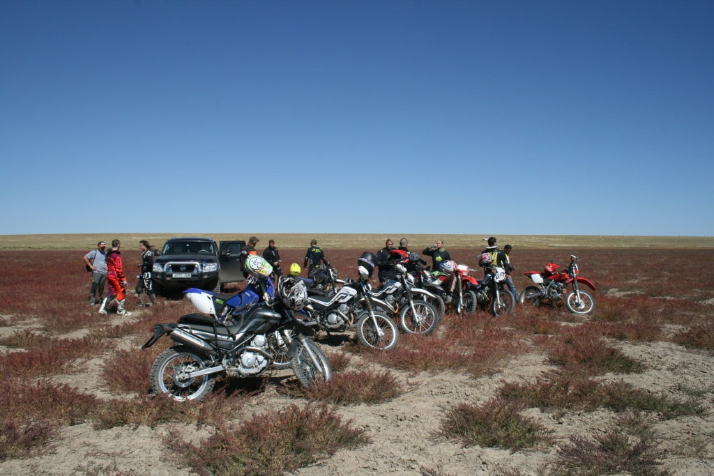 Taking a break to enjoy the surroundings on a Mongolia by motorcycle