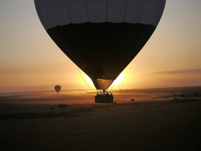 """""""Hot air balloon against sunrise at Masai Mara"""""""