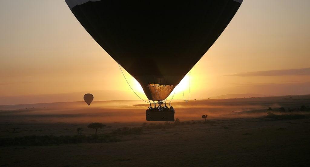 Hot air balloon against the sunrise at Maasai Mara