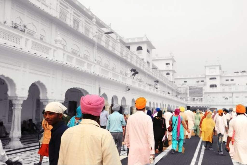 Devotees walking around The Golden Temple Amritsar