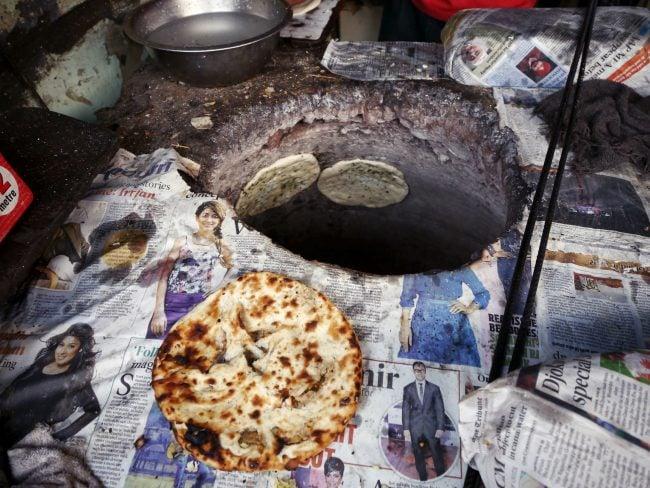 """Kulcha in the tandoori oven'"