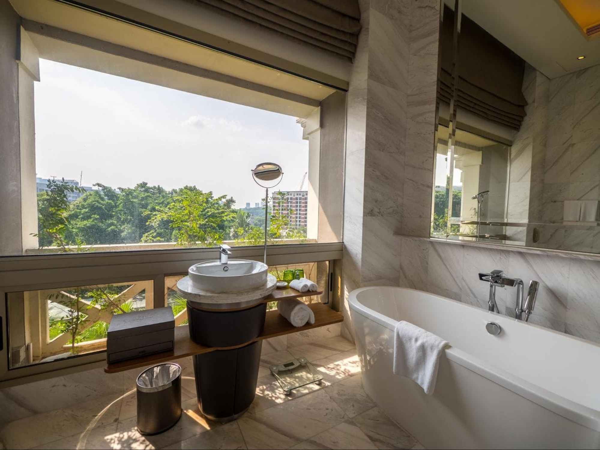 The sun-kissed verandah bathrooms at Hotel Fort Canning