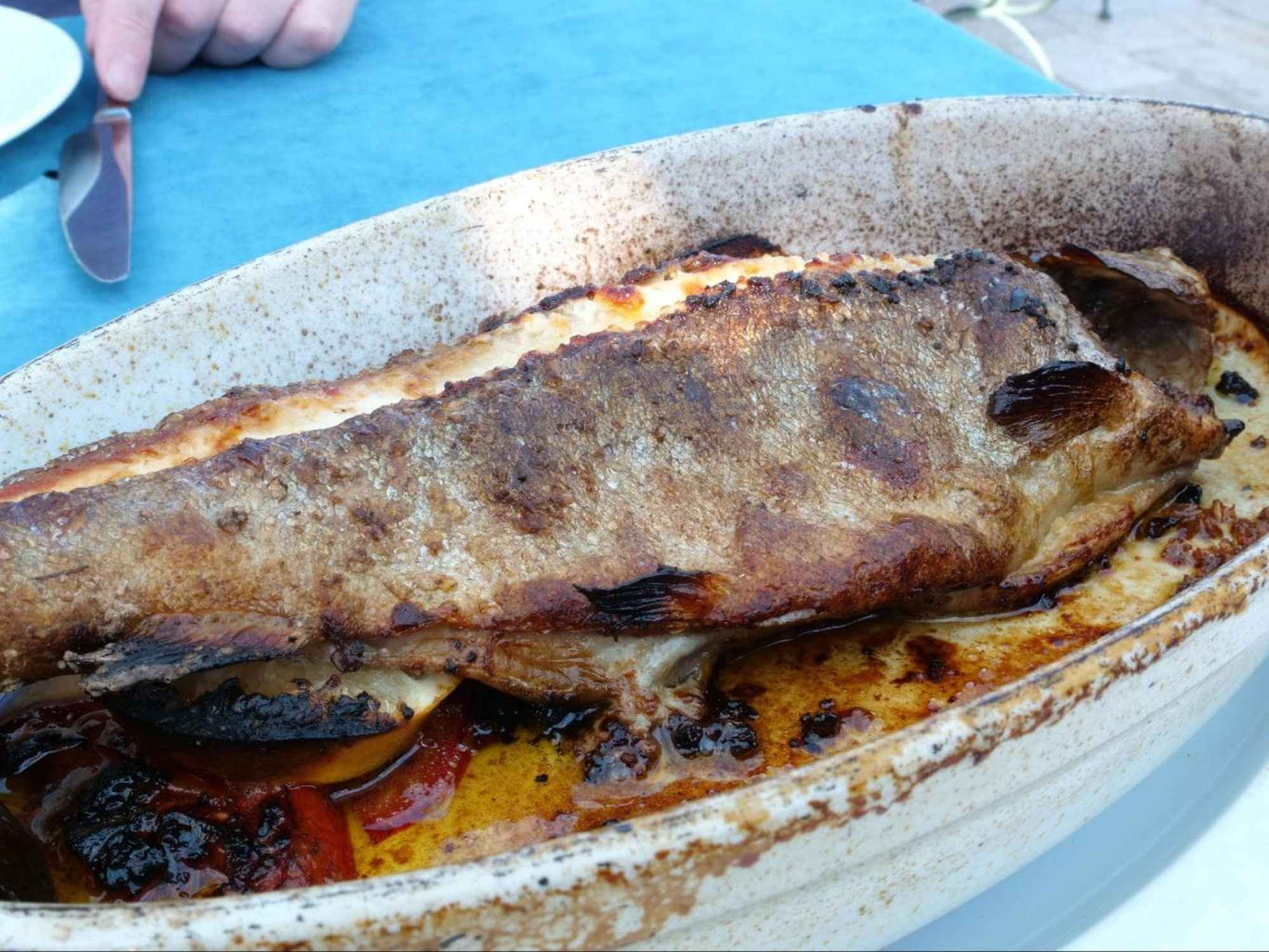 Baked whole sea bream fish