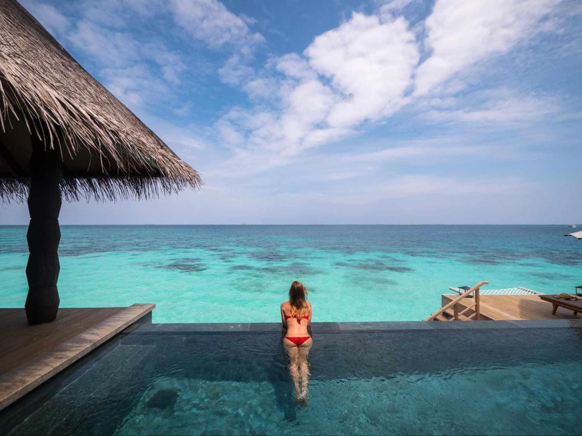 Infinity pool of the over water villas at Joali Maldives