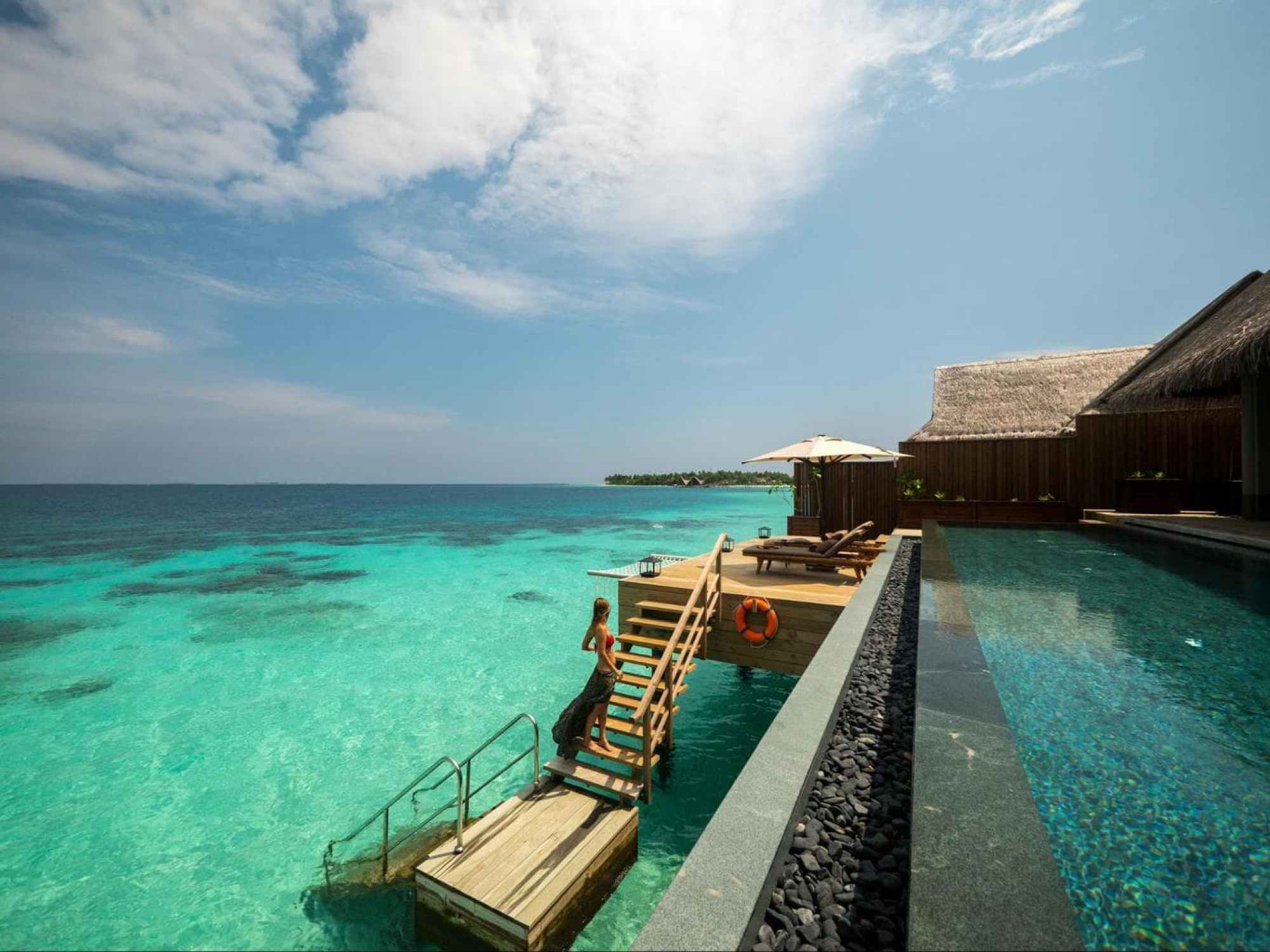 Outdoor decks of the over water villas at Joali Maldives