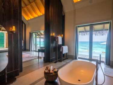 The bathrooms inside Joali's Luxury Water Villas