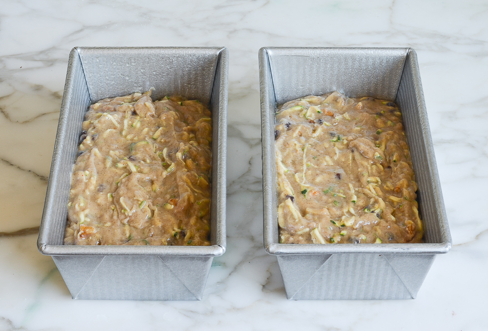 zucchini bread batter in greased baking pans