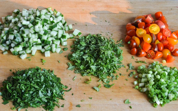chopped herbs and vegetables for tabbouleh