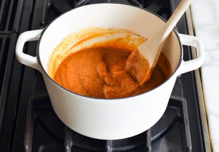 stirring pumpkin butter