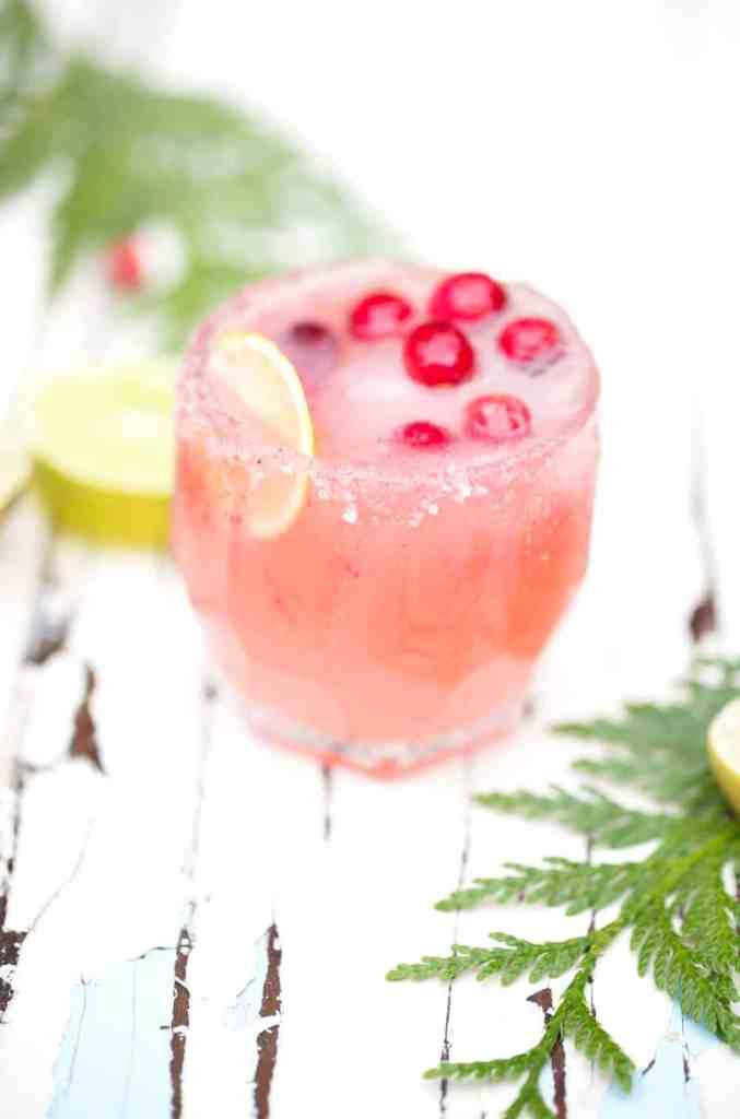 Cranberry Citrus Paloma Punch with cranberry sugar rim