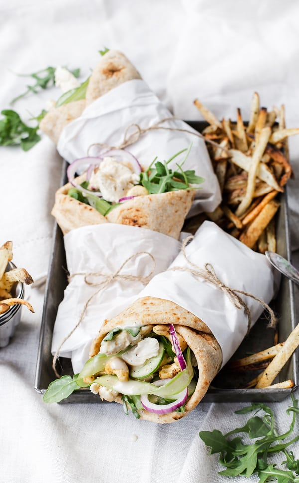 Cashew Caesar Chicken Wraps bring fresh flavor and texture to the table FAST whether served warm for dinner or wrapped up as a fabulous meal prep lunch. Chicken Caesar wrap pita recipe | chicken wrap | cashew chicken | howto make | recipe video #sponsored #feedfeed #annies