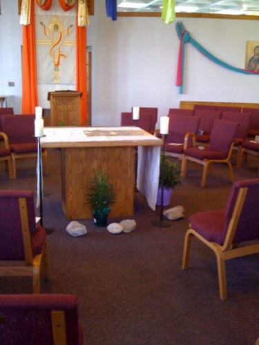 Rocks surround the altar and sit on chairs at St Nicholas Church