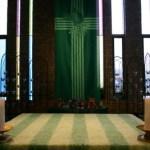 "Altar with green altar cloth and ""wheatsheaf cross"" green banner"