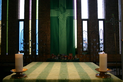 "Altar with green altar cloth and ""wheatsheaf cross"" green banner"