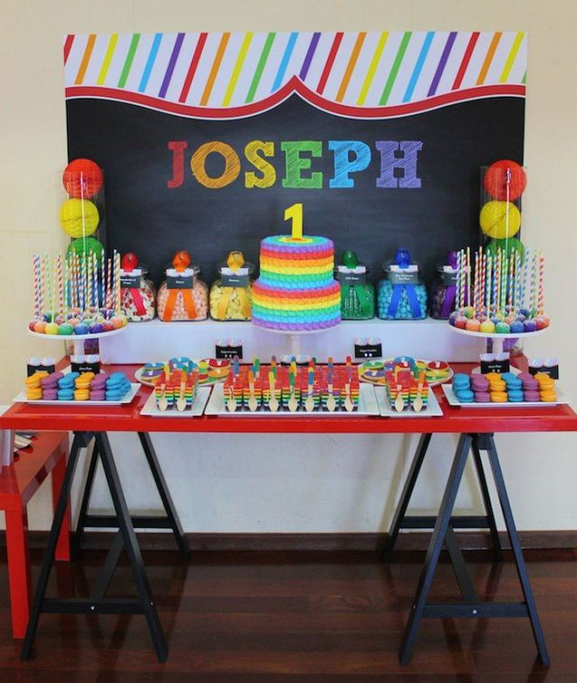 rainbow chalkboard dessert table