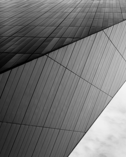 Vertical black and white photographic art print of buildings by Alan Moyle