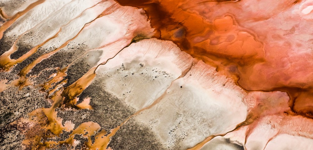 A Abstract, Aerial photo of Australia Landscape in Pink, Red, Brown and Orange .