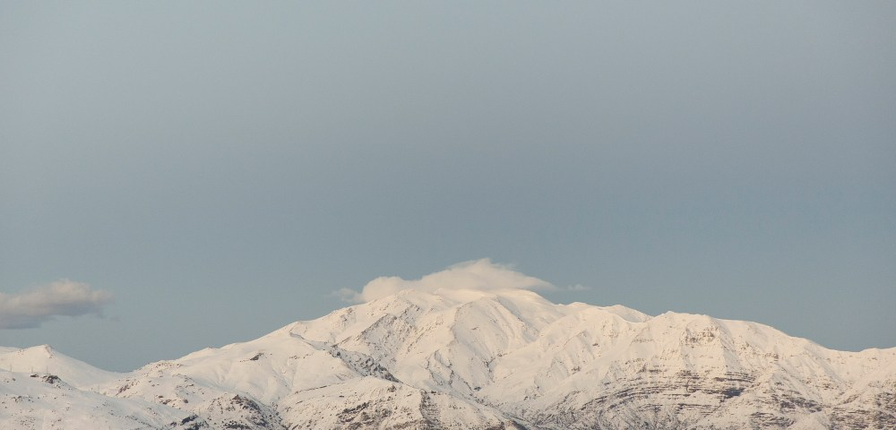 A photographic print taken in the Andes, Chile after a snowstorm. Colours in blue white and grey