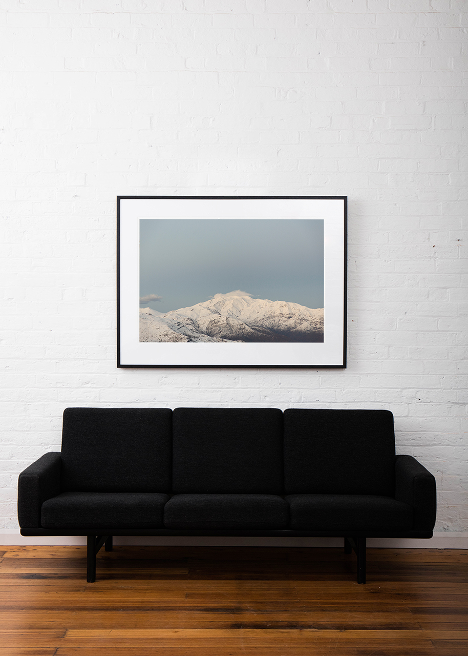 Large Photographic Landscape taken in the Andes, Chile of mountains, snow and clouds framed in black timber above sofa