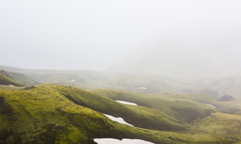 Misty Green Iclandic landscape of mountains and snow