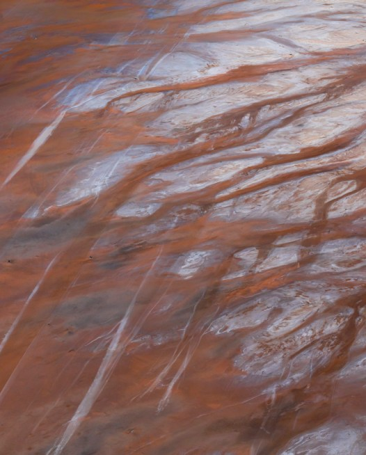 An aerial photo of inland Australian landscape in brown orange and grey colours