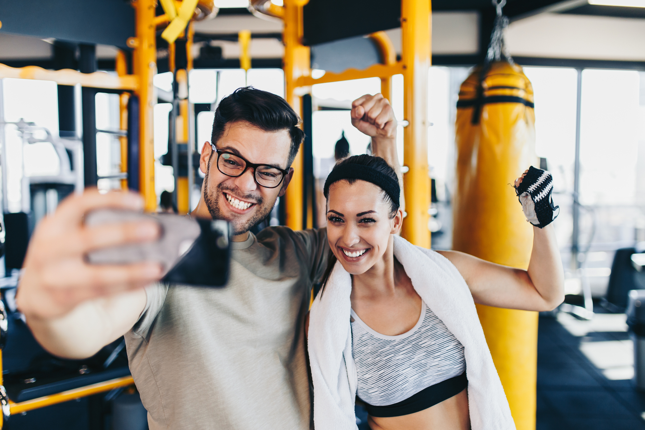 image of a man and a women taking a selfie while at the gym