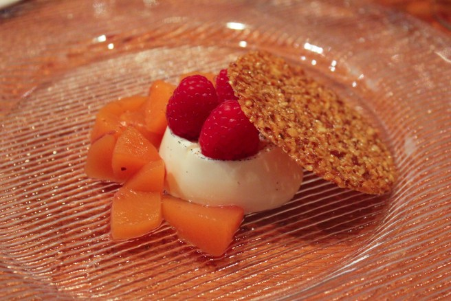 Peach Melba, Vanilla Bean Panna Cotta, Poached Peaches, Raspberries, Toasted Almond Tuile