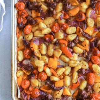 sheet pan gnocchi with vegetables and sausage on baking sheet