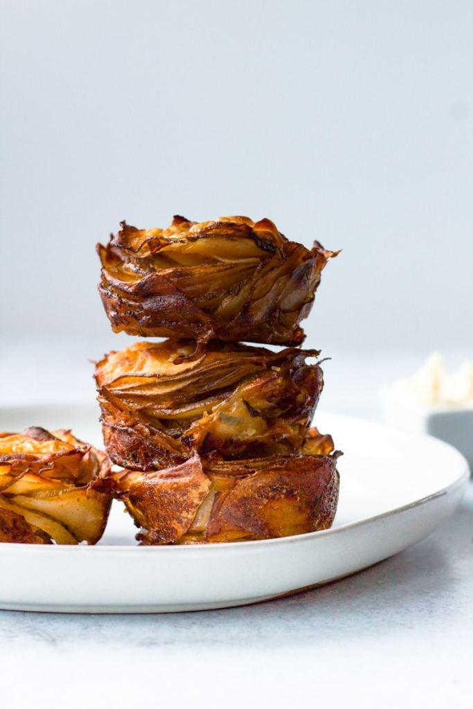 Three potato stacks on plate with garlic mayo