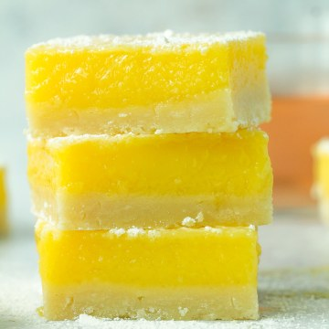 Stack of three lemon rosé bars with powdered sugar on top