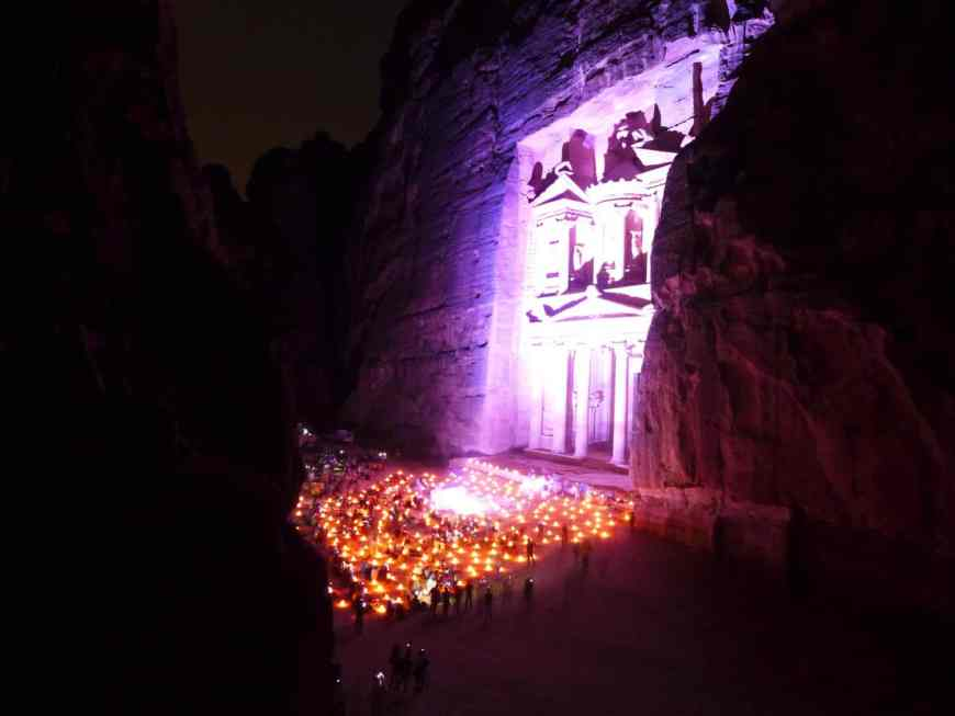 A secret viewing point for Petra by Night. This is a can't-miss experience when visiting Jordan | Tips for seeing Petra at Night, one of the Seven Wonders of the World | Lost City of Petra at night, Wadi Musa, Jordan