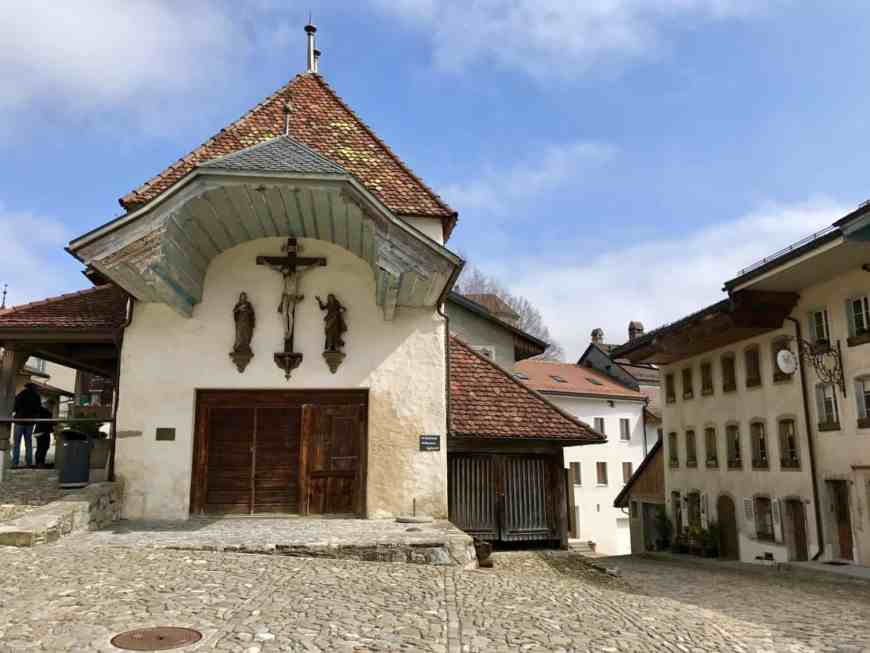 Gruyere is an easy day trip from Geneva and has amazing fondue and more! How to plan your trip to Gruyeres and why you have to visit Switzerland's most beautiful town.