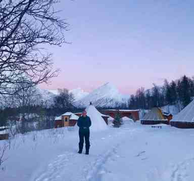 All about visiting Camp Tamok with Lyngsfjord Adventures outside of Tromso, Norway | A trip to the Arctic Circle in winter calls for an epic experience. We went dog sledding & slept in a traditional Sami lavvu tent, ate delicious food & soaked in stunning views | What to do in Tromso, sleeping in a Sami tent, Arctic adventures, mushing, dog sledding in Norway, what to do in Norway #tromso #norway #lyngsfjord #camptamok