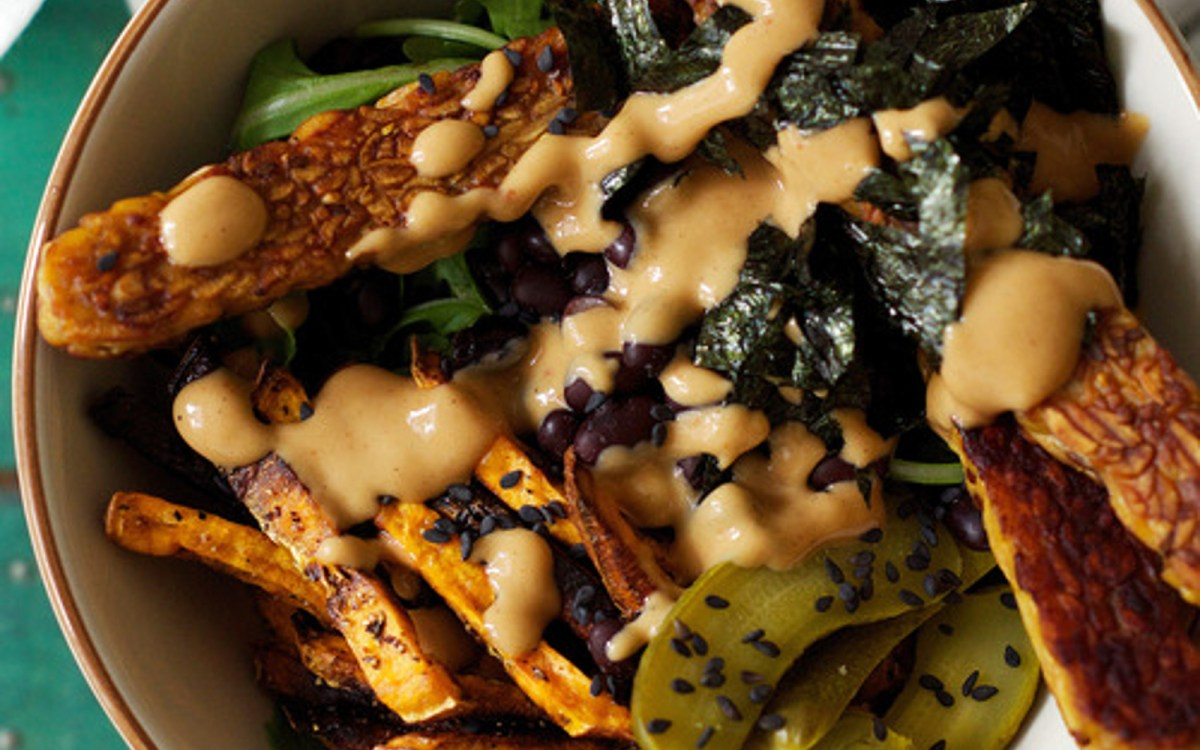 Wild Rice Bowl With Crunchy Sweet Potato Fries, Tempeh, Pickles, and Tahini Sauce