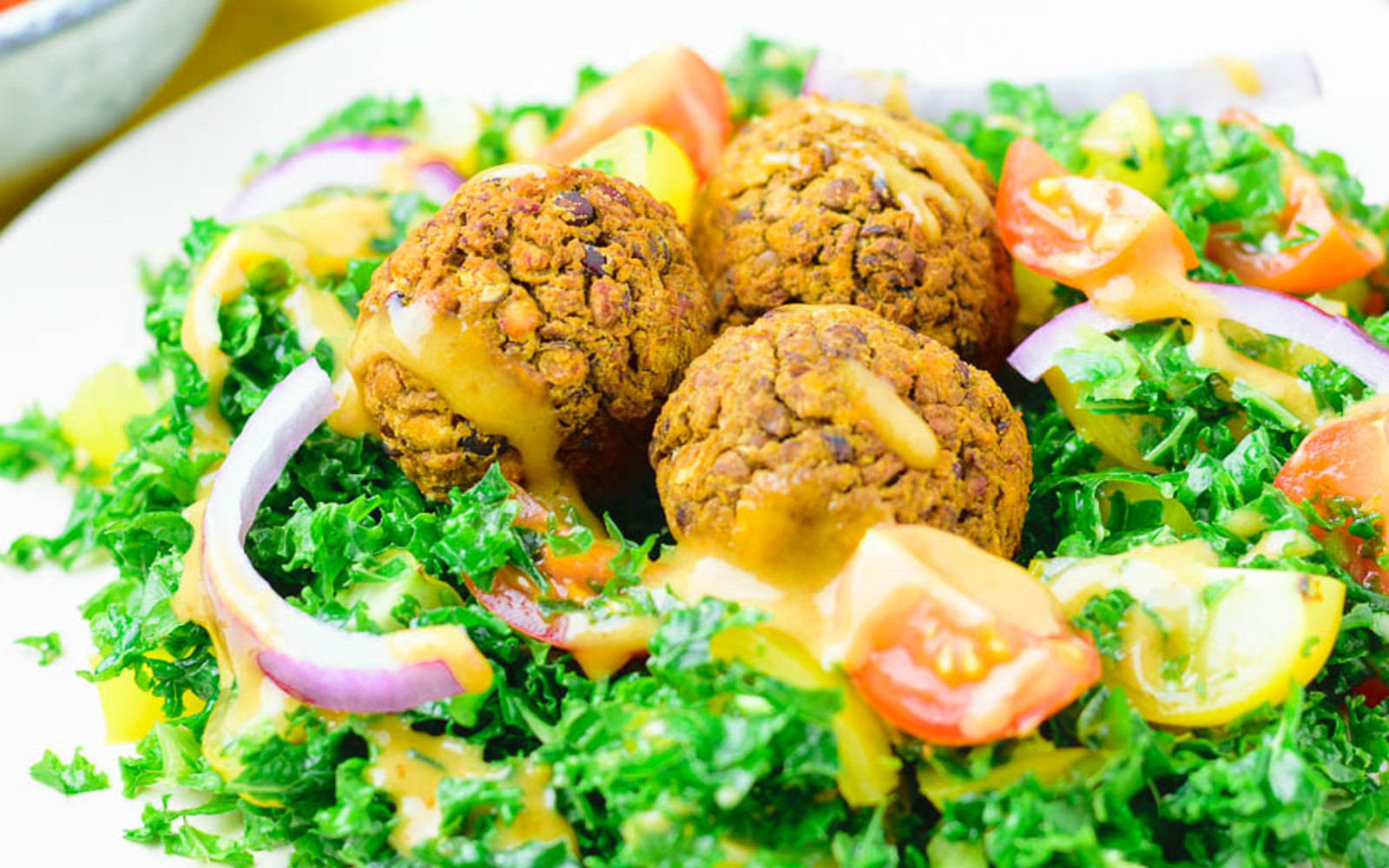 kale salad with lentil meatballs