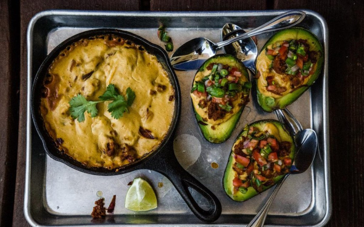 Baked and Stuffed Avocados With Cashew Queso and Sausage