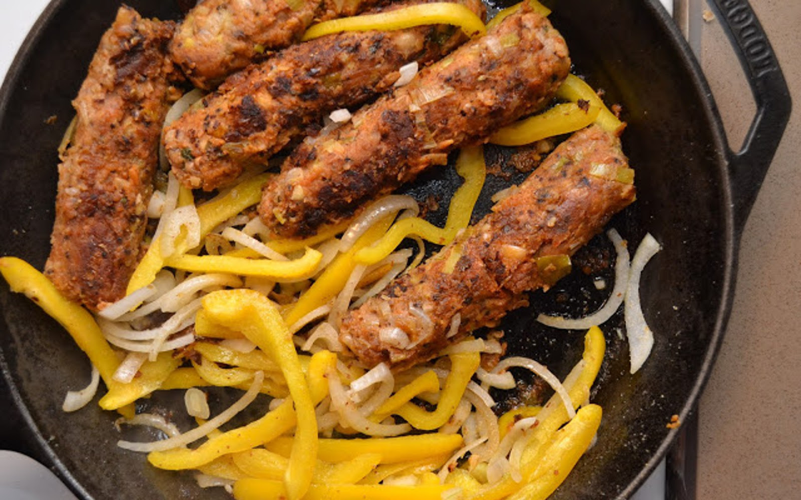 Vegan Black-Eyed Pea and Leek Sausages with peppers