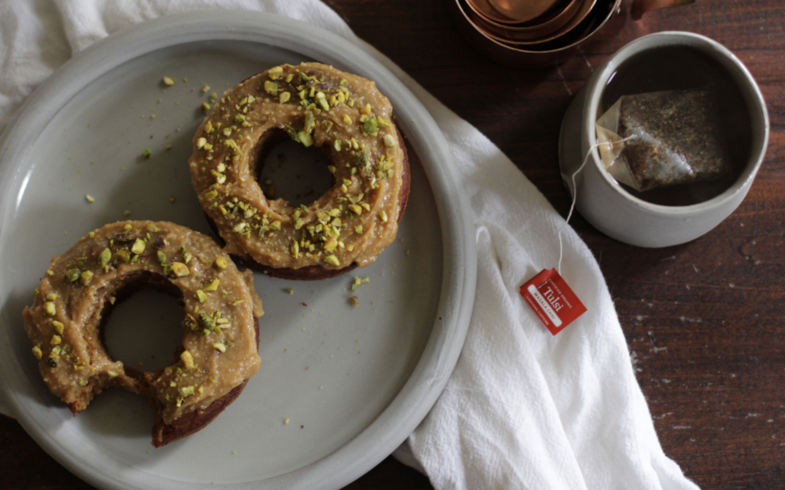 Vegan Gluten-Free Maple-Glazed Pumpkin Spiced Doughnuts with nut topping